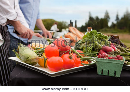 Fresh food being prepared outdoors - Stock Photo