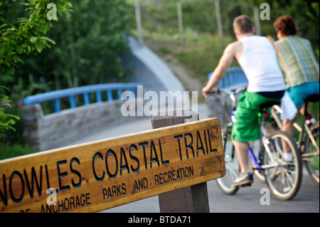Bicyclists enjoy the Tony Knowles Coastal Trail at Westchester Lagoon in Anchorage, Southcentral Alaska - Stock Photo