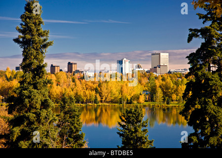 View of downtown Anchorage and Westchester Lagoon on a sunny day in Southcentral Alaska - Stock Photo
