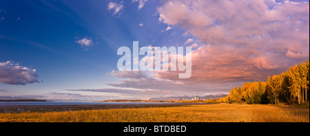 Sunset view of downtown Anchorage as seen from the Tony Knowles Coastal Trail, Anchorage, Southcentral Alaska, Fall - Stock Photo