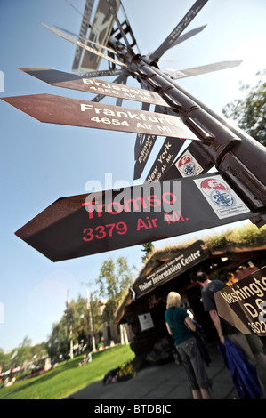 Mileage signpost outside of the Log Cabin and Downtown Visitor Information Center on Fourth Avenue in Anchorage, - Stock Photo