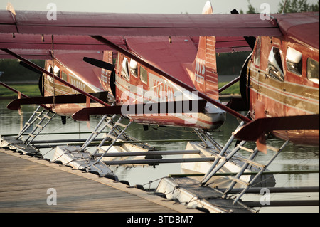 Group of Rust's Flying Service DeHavilland Beaver airplanes docked on Lake Hood in Anchorage, Southcentral Alaska - Stock Photo