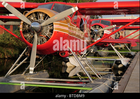Group of Rust's Flying Service DeHavilland Beaver's docked on Lake Hood in Anchorage, Southcentral Alaska - Stock Photo