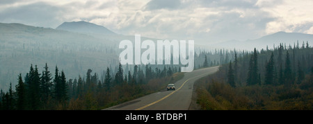 Car driving through a thick haze of wildfire smoke on the park road in Denali National Park & Preserve, Alaska - Stock Photo