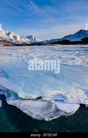 Sastrugi wind carved ridges in the snow covering frozen Phelan Creek alongside the Richardson Highway, Alaska Range, - Stock Photo