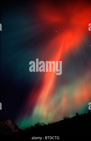 Red Northern Lights (Aurora Borealis) fill the night sky in Chugach State Park, Anchorage, Southcentral Alaska, - Stock Photo