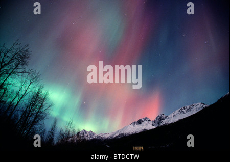 Multi colored Northern Lights (Aurora borealis) fill the night sky off the Old Glen Highway near Palmer, Alaska, - Stock Photo