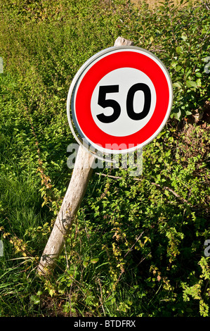 Modern road traffic sign indicating 50 kph speed limit - Indre-et-Loire, France. - Stock Photo