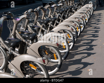 Row of public rental bicycles called Velib on Paris street in France - Stock Photo