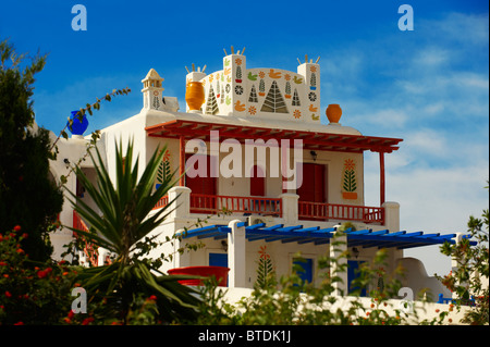 House decorated with traditional folk art. Mykonos, Cyclades Islands, Greece. - Stock Photo