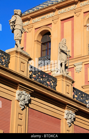 Statues of Velazquez and Ponce del Leon atop the facade of Palace of San Telmo in Seville, Spain - Stock Photo