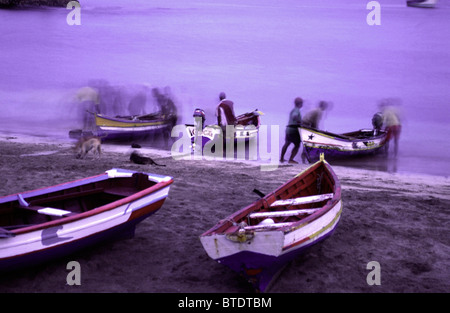 Fishermen prepare their boats in the early morning - Stock Photo