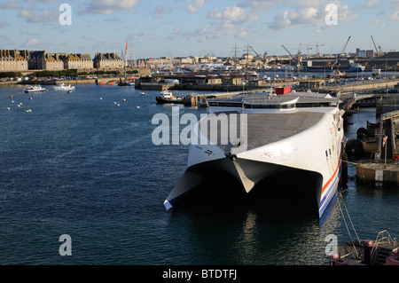 RORO fastcat ferry Condor Rapide with the backdrop of St Malo a historic town and port in western France - Stock Photo