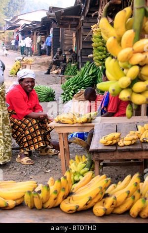 Woman selling bananas at the market in Gisankura Village - Stock Photo