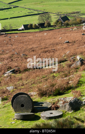 Abandoned millstones and Overstones Farm below Stanage Edge in the Peak District, Derbyshire, England - Stock Photo