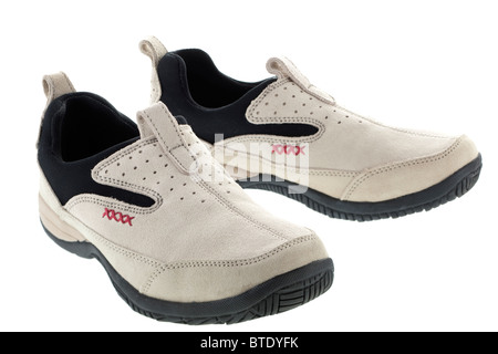Pair of Uk size 5 ladies casual rubber soled stretch mesh upper suede stone coloured everday slip on trainer type - Stock Photo