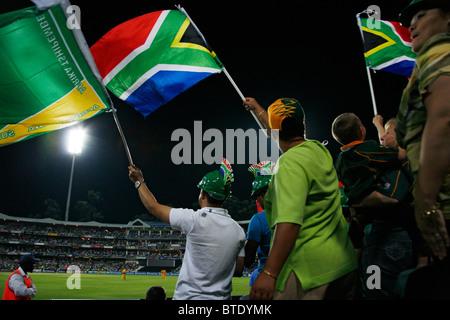 Cricket fans at a Pro20 international cricket match - Stock Photo
