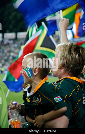 Mother and son cricket fans cheering at an international Pro20 cricket match - Stock Photo
