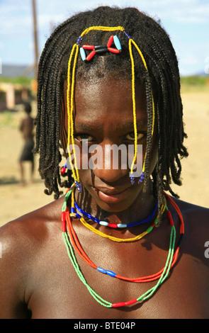 Young Herero woman wearing colourful beaded jewellery - Stock Photo