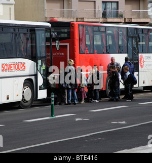 Schoolchildren boarding a educational tour bus - Stock Photo