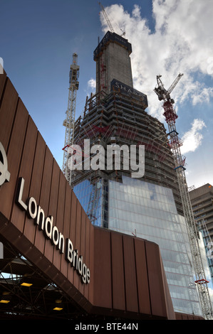 The Shard skyscraper under construction at London Bridge in London, UK - Stock Photo