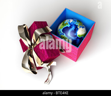 Gift package, with ribboned open cup, with planet earth inside, viewed from above. - Stock Photo