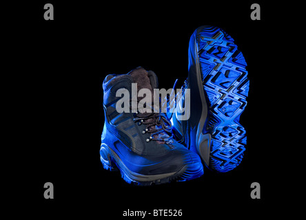 trekking boots shoes in blue carefree free go going light foot feet cutout - Stock Photo