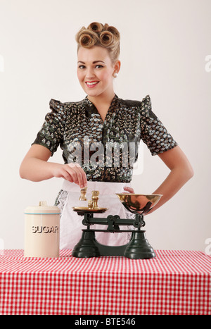 Retro housewife with scales - Stock Photo