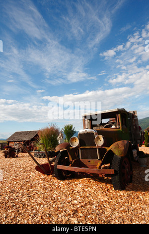 Old truck at Log Barn on route 97A (British Columbia) - Stock Photo