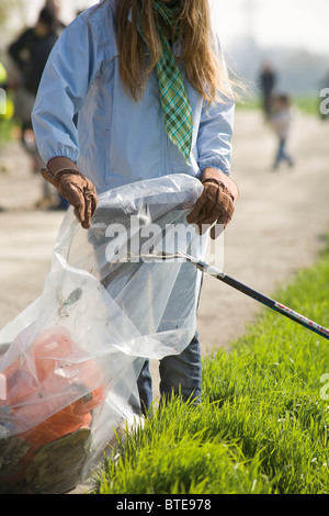 Volunteers cleaning up trash outdoors - Stock Photo