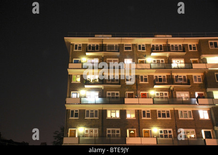 Apartment Building At Night view from balcony at night with apartment buildings and table