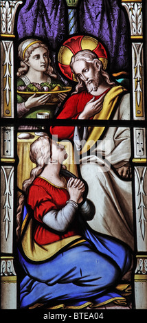 A stained glass window depicting Jesus in the house of Martha and Mary, Parish Church of St Mary Magdalene, Clatworthy, - Stock Photo