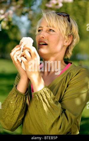Woman suffering from hay fever - Stock Photo