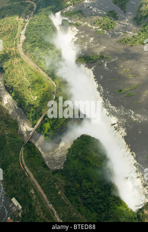 An aerial view of the Victoria falls and the bridge over the Devils Cataract gorge linking Zimbabwe and Zambia - Stock Photo