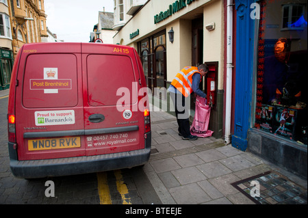 Royal Mail postman collecting post, Aberystwyth Wales UK - Stock Photo