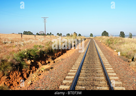 Railway line disappearing into the distance - Stock Photo