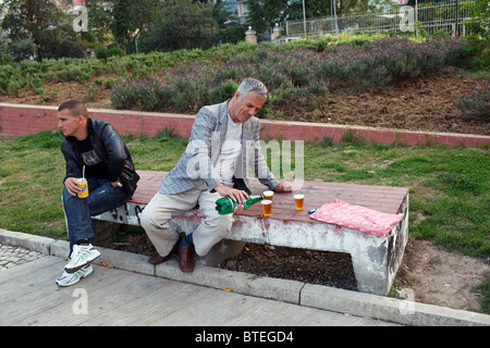 A man pours beer in a park in Tirana, the capital of Albania. - Stock Photo