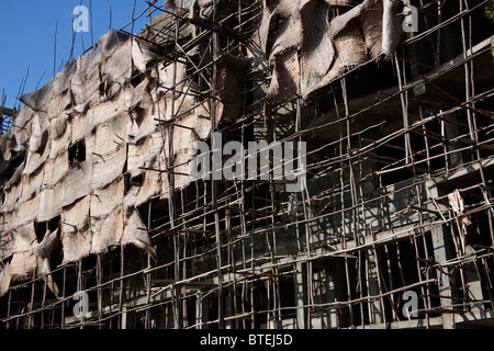 Construction scaffolding and screens in downtown Awassa on a multi-story building - Stock Photo