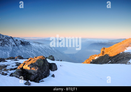 Winter sunrise view over Scafell, Wasdale and Wastwater from Great Gable in the English Lake District - Stock Photo