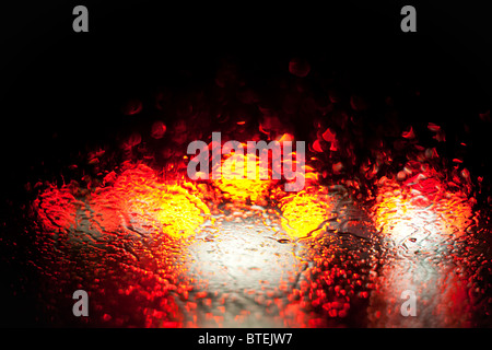 blurred car lights in the rain - Stock Photo