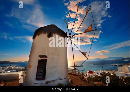 Sunset over the The traditional Greek windmills of Mykonos Upper Chora. Cyclades Islands, Greece - Stock Photo