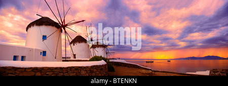 Sunset over the traditional Greek windmills of Mykonos Chora. Cyclades Islands, Greece - Stock Photo