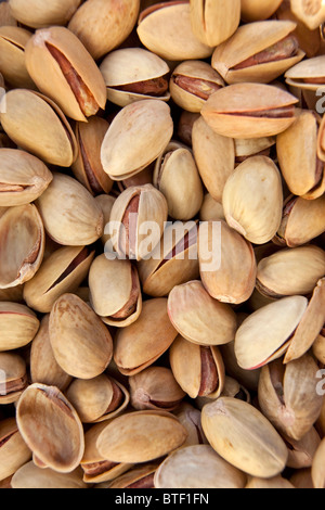 macro close up of salted pistachio nuts - Stock Photo