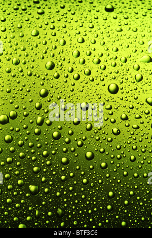 Texture of water drops on the bottle of beer.