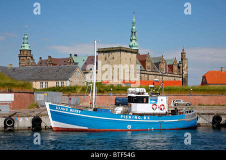 The fishing boat Hanne Berit in front of the renaissance castle Kronborg in Elsinore, Denmark, seen from the port - Stock Photo