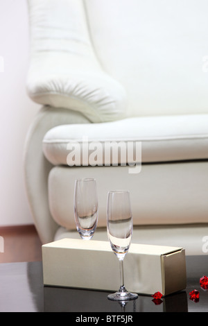 A studio shot of a detail of white leather sofa in a living room - Stock Photo