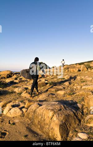 Tunisia, surfers walking to beach, Mediterranean Sea. - Stock Photo