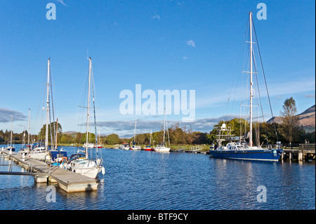 Yachts & motor boats moored on the Caledonian Canal in Banavie near Fort William in Scotland - Stock Photo