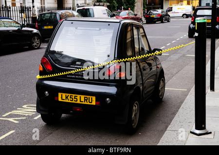 An Electric Car being recharged, Albemarle Street, Mayfair, London, England, UK - Stock Photo