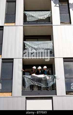 Property developer meeting with business people at building under construction - Stock Photo